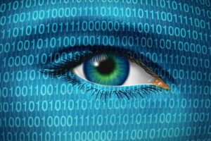 Internet security and privacy issues with a human eye and digital binary code representing surveillance of hackers or hacking from cyber criminals  watching prohibited access to web sites with firewalls.